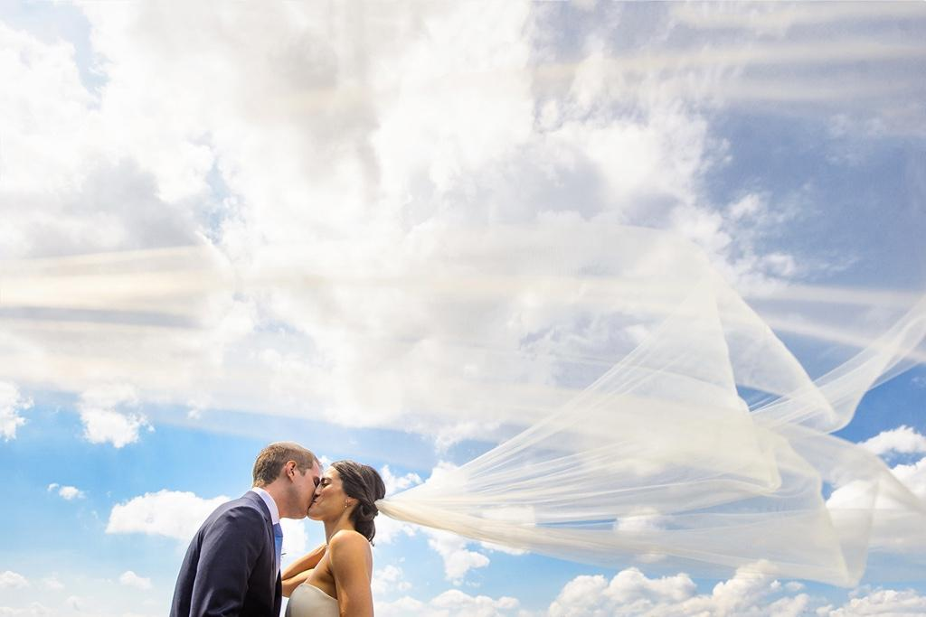 Daniel Moyer Photography, bride and groom kissing with clouds and veil