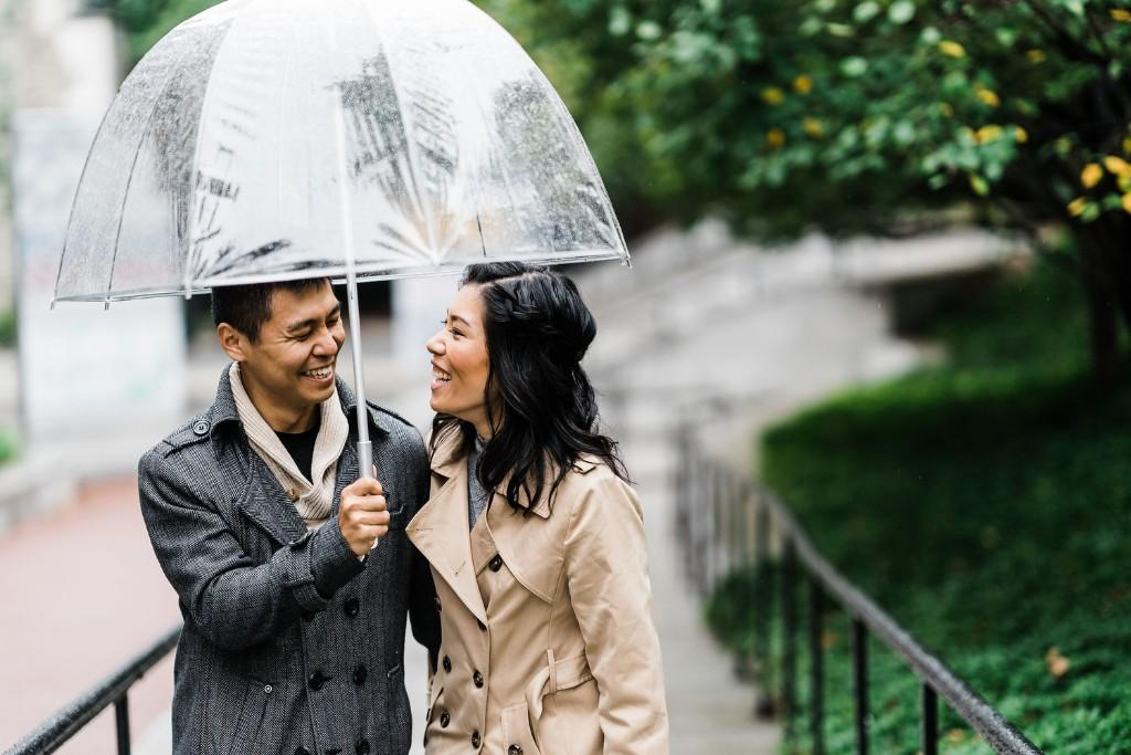 Couple with umbrella in rain during engagement shoot, J&J Studios