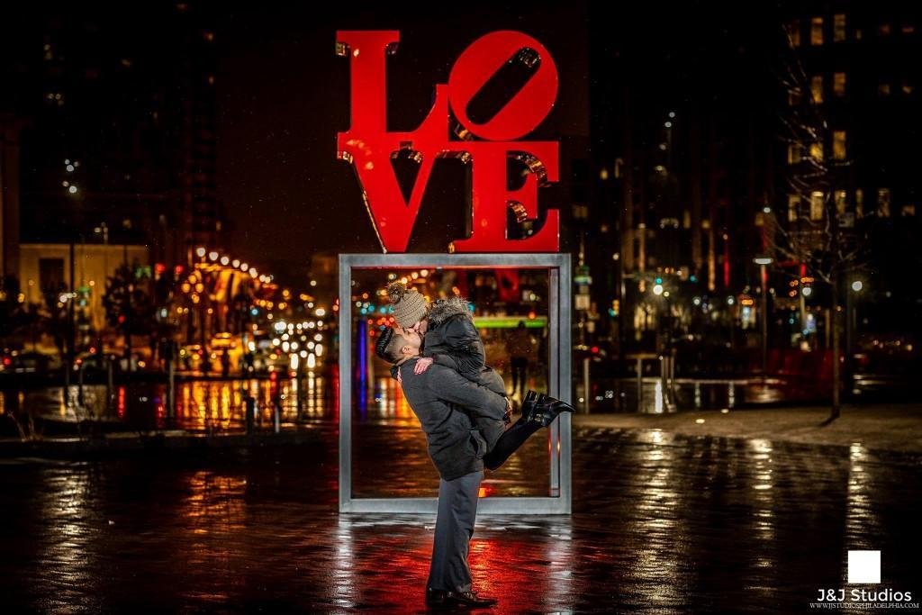 bride and groom at love statue in philadelphia
