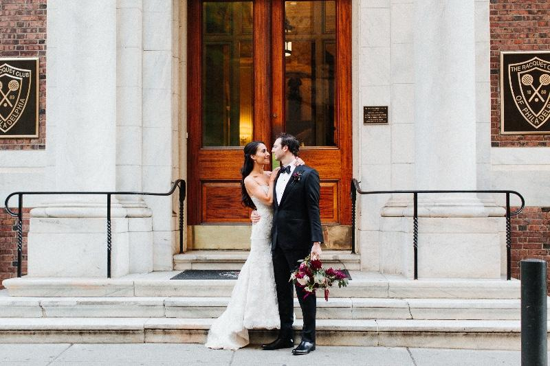 bride and groom in front of the racquet club of philadelphia, philadelphia wedding venues